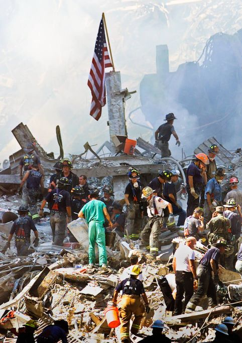 Rescue workers climb on piles of rubble at the World Trade Center in New York, Sept. 13, 2001. Beth A. Keiser | AP